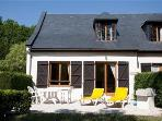 Cottage style Gite, Terrace with BBQ small grassed front garden , p,easing views, partly secluded.