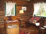 Hardwood floors in entry way of the cabin, we call this the Frontier Room