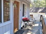 Front door with deck and charcoal grill