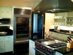 Professional kitchen with SubZero glass front R/F, Viking Gas Range & Oven, Stand Alone Ice-maker