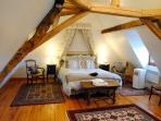 Beautiful french drapes and comfortable beds  - a large airconditioned bedroom upstairs