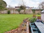 Back garden with outdoor seating and bbq