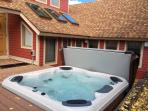 Recessed Bullfrog spas hot tub on deck just steps from the door