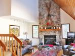 Entertain in the Great Room with it's soaring ceilings and Stone Fireplace