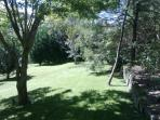 Large grounds with natural spring and award winning Paul Sorensen gardens with dry-stone walls