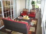 Three sliding doors open to the 35 foot patio which overlooks Thousand Hills Golf Course & theaters