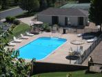 View of outdoor pool from our enclosed patio
