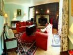 Main Sitting room with period features and comfy sofas