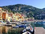 Looking towards the Old Town and quay of Villefranche from the Port.