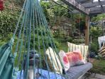 Swings around the back yard pergola