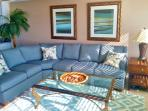 Queen size L shaped sleeper sofa, stone tile, wool rugs, balcony access, Wall of windows to the GULF