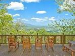 Front deck with rocker chairs offer beautiful views of the valley and the mountains.