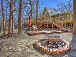 Enjoy the cozy fire pit at this Pottsboro vacation rental house!