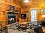 Living room with gas log fireplace and sleeper sofa