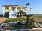 Front of the house with intracoastal behind it
