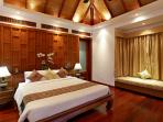 Master bedroom overlooking pool and Bang Tao bay