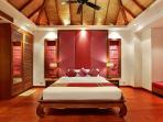 Upper level purple guest bedroom