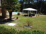 A view of the pool and gazebo from the driveway