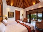Upper level pool side bedroom with view to Bang Tao bay and en-suite shower room