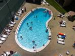 Heated pool is great for relaxing by or taking a swim.
