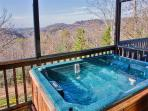 Unwind in this private screened-in hot tub while admiring the breathtaking views