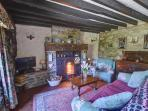 A characterful sitting room with attractive original features including a Victorian range