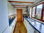The kitchen is well fitted and equipped, and there is a separate utility room