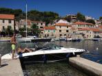 rent our speed boat with skipper for excursions around the island or to Brac or Hvar