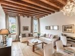 an elegant environment with antique wooden beams and massive floor-boards