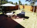 Nice fenced back yard with Patio, BBQ & Hammock under the Palm Tree