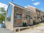 THE BARN AT GLANOER, stone-built barn conversion, roll-top bath, woodburner, an away-from-it-all location, near Hundred House, Ref 22968
