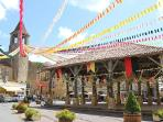 Belves in the summer with bunting for the festival