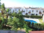 View from the terrace to the comunity gardens and swimingpool.