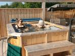 cool/cold tub situated on the top level of 3 levels of decks. Swing and sitting area adjacent.