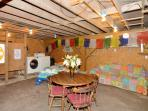 Bonus room!  With shower,  powder room, darts, washer dryer, pull out sofa. a/c,  FUN!