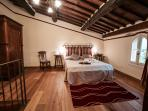 Attic suite. Tuscan old style. Beautiful wooden decoration. View down on the wonderfull valley.