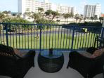 Relax on this beautiful ocean view balcony 4 large chairs & dining table &chairs