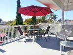 Large deck with table and chairs for great sunsets