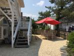 Full Access to Backyard. 2 outside table w/ 8 chairs and market umbrellas BBQ Grill. Outside Shower