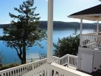 5.  Waveside Dream Cottages -  Two small cottages on a terraced waterfront -- share with friends.