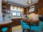 Fully equipped kitchen on the lower floor next to the Playroom