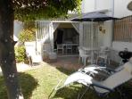 Private front garden with table, chairs & BBQ. Reclining chairs may also be taken to the pool area