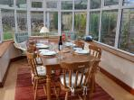 The conservatory makes a lovely dining area .... overlooking the private garden.