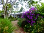 An enchanting colorful Entrance and walkway to the Homestead at Riverbend