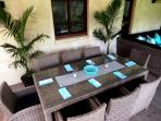 The palm Lounge Dining area, perfect for outdoor shaded area dining at Riverbend