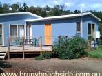 Four bedrooms. Two bathrooms. On the esplanade beside the beach!