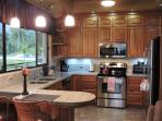 Solid Teak cabinets, granite counter tops, stainless steel appliances and views to die for.