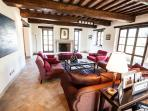 The comfortable Drawing Room overlooking the pool and garden