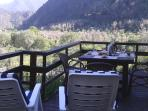 From the terrace next to the dining area you have a great view over the river and the mountains.
