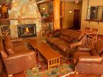 The lodge's lobby features a stunning, central fireplace and huge, log beams
